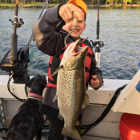young child can barely hold up a nice Lake Ontario brown trout